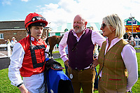 Jockey Finley Marsh talks to connections of Beepeecee in the winners enclosure during Afternoon Racing at Salisbury Racecourse on 13th June 2017