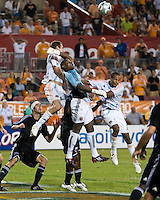 D.C. United goalkeeper Louis Crayton (27) punches the ball away from Houston Dynamo forward Nate Jaqua (27)and Houston Dynamo midfielder Ricardo Clark (13).  Houston Dynamo tied D.C. United 0-0 at Robertson Stadium in Houston, TX on October 12, 2008.  Photo by Wendy Larsen/isiphotos.com