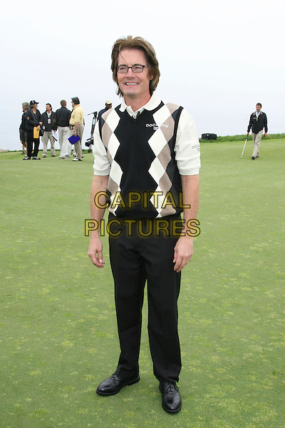KYLE MacLACHLAN.9th Annual Michael Douglas & Friends Celebrity Golf Event.held at the Trump National Golf Club, Rancho Palos Verdes, California, USA. .April 29th, 2007.sport full length black trousers argyle jumper.CAP/ADM/RE.©Russ Elliot/AdMedia/Capital Pictures