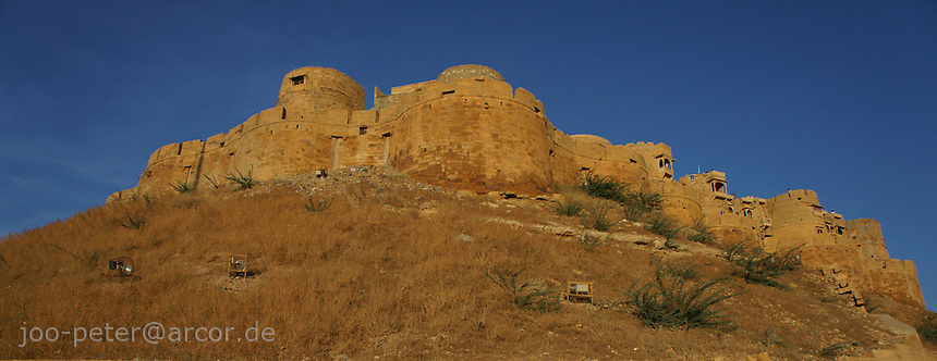 """Jaisalmer Fort early in the morning, Rajastan, India. Jaisalmer is also called """"Golden city"""" because of the yellowisch sandstone."""