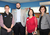 NWA Democrat-Gazette/CARIN SCHOPPMEYER Margot Lemaster, Ozark Literacy Council executive director (from right), is joined by Chung Tan, Sam Marshall and Cody Black, board members, at the April 6 open house.