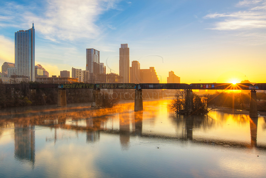 The warmth of sunrise on a very cold January morning filters through Austin and Lady Bird Lake. This image, taken from the Pedestrian Bridge that connects downtown to Zilker Park, offers great views of the highrises.