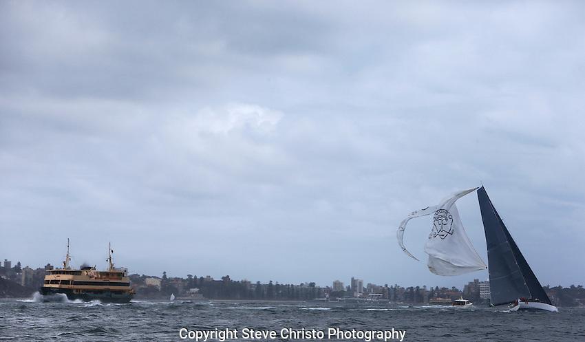 2012 SOLAS Big Boat Challenge on Sydney Harbour, last years Rolex Sydney to Hobart winner Loki rips her spinnaker. Sydney Australia. 11th December  2012. Photo Steve Christo