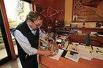 Company Founder Ernesto Colnago explains the special medallion showing the history of the company, and still working every day at the Colnago Factory, Cambiago, Italy. 30th September 2015.<br /> Picture: Eoin Clarke | Newsfile