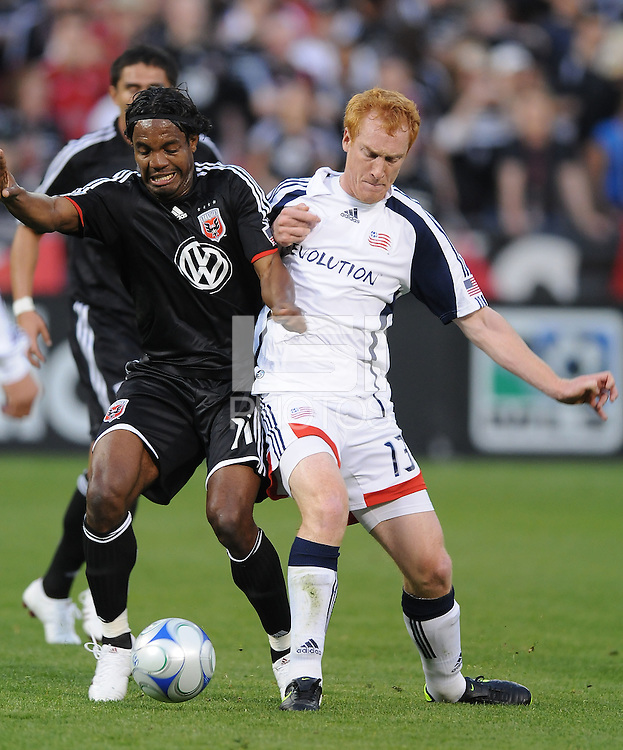 DC United  forward Luciano Emilio (11) fights for possession of the ball against New England Revolution midfielder Jeff Larentowicz (13)  DC United tied The New England Revolution 1-1 at  RFK Stadium, Friday April 17, 2009.