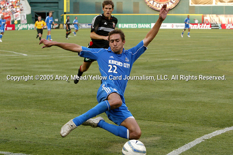 9 July 2005: Davy Arnaud (22) makes a diving lunge in an unsuccessful attempt to keep the ball in play. The Kansas City Wizards defeated DC United 1-0 at RFK Stadium in Washington, DC in a regular season Major League Soccer game. . .