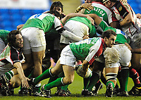 Reading, GREAT BRITAIN,Exiles, Paul HODGSON, feels the tap of Issac BOSS, around his ankles, during the third round Heineken Cup game, London Irish vs Ulster Rugby, at the Madejski Stadium, Reading ENGLAND, Sa, t 09.12.2006. [Photo Peter Spurrier/Intersport Images]..