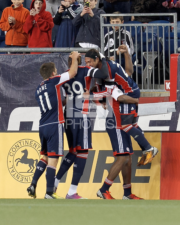 New England Revolution midfielder Lee Nguyen (24) celebrates his goal with teammates. In a Major League Soccer (MLS) match, the New England Revolution (blue/red) defeated Philadelphia Union (blue/white), 2-0, at Gillette Stadium on April 27, 2013.