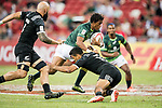 Stedman-Ghee Gans of South Africa runs with the ball while New Zealand players try to stop him, during the match South Africa vs New Zealand, Day 2 of the HSBC Singapore Rugby Sevens as part of the World Rugby HSBC World Rugby Sevens Series 2016-17 at the National Stadium on 16 April 2017 in Singapore. Photo by Victor Fraile / Power Sport Images