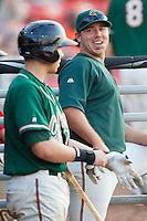 Greensboro Grasshoppers hitting coach Kevin Randel #12 chats with Kyle Skipworth #11 at  L.P. Frans Stadium July 10, 2010, in Hickory, North Carolina.  Photo by Brian Westerholt / Four Seam Images