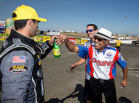 Jul. 28, 2013; Sonoma, CA, USA: NHRA pro stock motorcycle rider Hector Arana Sr (right) celebrates with pro stock driver Vincent Nobile after winning the Sonoma Nationals at Sonoma Raceway. Mandatory Credit: Mark J. Rebilas-