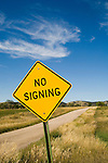 No Signing--yellow diamond traffic sign states the obvious in rural South Dakota.