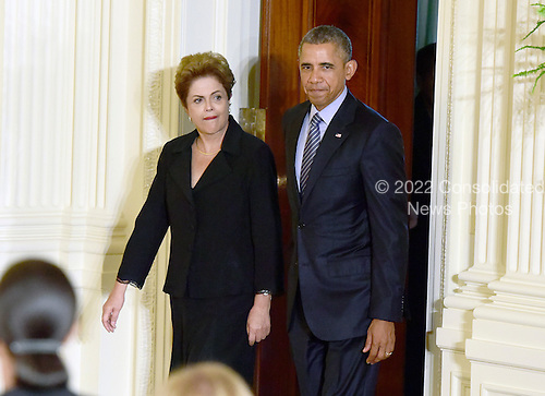United States President Barack Obama, right, and President Dilma Rousseff of Brazil, left, arrive in the East Room of the White House in Washington, D.C. to conduct a joint press conference on Tuesday, June 30, 2015.<br /> Credit: Ron Sachs / CNP
