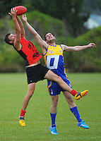 Zach Inglis (left) and Aaron O'Neil compete for the ball during the Wellington Australian Rules Football National Provincial Championship final match between the Canterbury Cobras (black and red) and Otago Riot (blue and gold) at Hutt Park, Wellington, New Zealand on Saturday, 6 December 2014. Photo: Dave Lintott / lintottphoto.co.nz