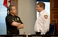 City of Fayetteville Police chief Mike Reynolds (left) and fire chief Brad Hardin visit before a press conference Wednesday, March 18, 2020, with mayor Lioneld Jordan at City Hall about the first resident of Fayetteville with a presumptive case of covid-19. Check out nwaonline.com/200319Daily/ and nwadg.com/photos for a photo gallery.<br /> (NWA Democrat-Gazette/David Gottschalk)