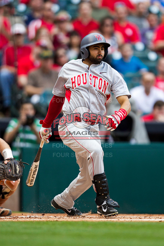 Houston Cougars shortstop Frankie Ratcliff #7 follows through on his swing during the NCAA baseball game against the Texas Longhorns on March 1, 2014 during the Houston College Classic at Minute Maid Park in Houston, Texas. The Longhorns defeated the Cougars 3-2. (Andrew Woolley/Four Seam Images)