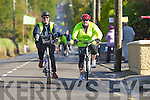 Cyclists Noree O'Sullivan and Ann Bergen pass through Currow village during the Castleisland fun cycle on Sunday ..