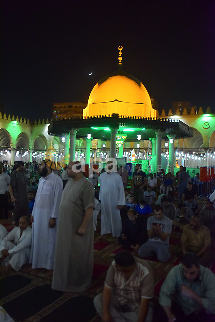 "Egyptian worshipers perform take part in an evening prayer ""Taraweeh"", at Amr Ibn al-Aas mosque, in Cairo on May 30, 2017. Ramadan is sacred to Muslims because it is during that month that tradition says the Koran was revealed to the Prophet Mohammed. The fast is one of the five main religious obligations under Islam. More than 1.5 billion Muslims around the world will mark the month, during which believers abstain from eating, drinking, smoking and having sex from dawn until sunset. Photo by Amr Sayed"