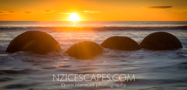 Sunrise on beach with Moeraki Boulders, Coastal Otago, East Coast, New Zealand