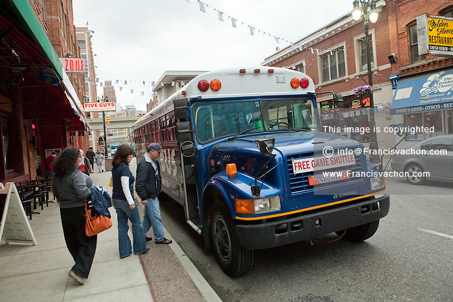 A group hop in Tigers Game bus shuttle in Detroit (Mi) Friday June 7, 2013.