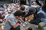 Refugees find shoes for a little girl at a makeshift refugee camp where people brought in donated clothes.<br /> <br /> Hundreds of refugees from mostly Syria and Afghanistan gather at the Budapest Keleti railway station waiting for trains to leave for destinations such as Austria, Germany and Sweden, in Budapest, Hungary, on Tuesday, Sept. 8, 2015. Hungary's Prime Minister Viktor Orban created an anti-refugee campaign to generate hate against those fleeing war in their home countries. The country is currently 50% xenophobic and the government has become increasingly authoritarian.