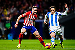 Saul Niguez of Atletico de Madrid (L) fights for the ball with Andoni Gorosabel of Real Sociedad (R) during the La Liga 2018-19 match between Atletico de Madrid and Real Sociedad at Wanda Metropolitano on October 27 2018 in Madrid, Spain.  Photo by Diego Souto / Power Sport Images