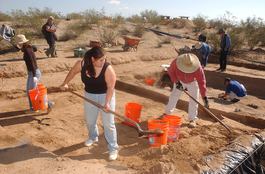 Marty Robistow (white pants) who is finishing his undergraduate work at the University of Arizona shovels dirt from the Marana Platform Mound with University of Hawaii student Esme Hammerle......