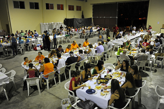Villagers attend a town dinner in the gymnasium during the municipal fiestas in the town of Costur, Spain on August 18, 2009.