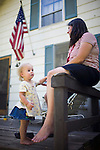 Ivy Ferrell, left, relaxes with her mom, Sharon Ferrell on the porch of their home in Lincoln, CA May 13, 2009.