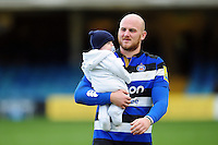 Matt Garvey of Bath Rugby with his baby daughter after the match. Aviva Premiership match, between Bath Rugby and Saracens on December 3, 2016 at the Recreation Ground in Bath, England. Photo by: Patrick Khachfe / Onside Images