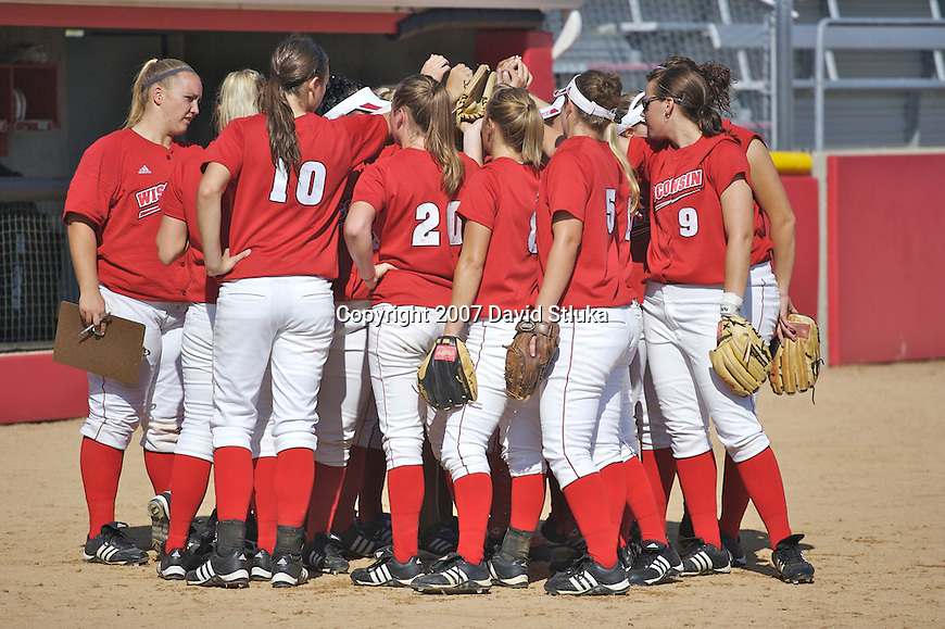 MADISON, WI - OCTOBER 6: The Wisconsin Badgers softball team huddles during the game against UW-Parkside at the Goodman Softball Complex in Madison, Wisconsin on October 6, 2007. The Badgers beat UW-Parkside 5-4. (Photo by David Stluka).
