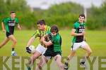 Cathal O'Sullivan,Lispole shields the ball,while Churchill's Diarmuid McGarry nearly looses his gum shield when the sides clashed at the Spa last Saturday evening