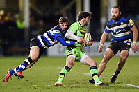 Ben Foden of Northampton Saints is tackled by Darren Atkins of Bath Rugby. Aviva Premiership match, between Bath Rugby and Northampton Saints on February 9, 2018 at the Recreation Ground in Bath, England. Photo by: Patrick Khachfe / Onside Images