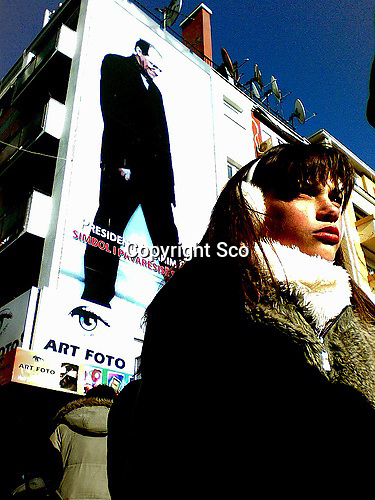 A girl walking past a huge poster of Ibrahim Rugova (1944-2006), Kosovo's first rock-collecting president.