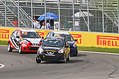 Three Nissan Micras battle it out at the hairpin corner of the Circuit Gillles-Villeneuve during the Grand Prix of Canada on the 6th of June at Circuit Gilles-Villeneuve