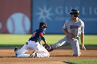 Salem Red Sox shortstop Jose Vinicio (3) puts the tag on Adam Engel (7) of the Winston-Salem Dash as he tries to steal second base at LewisGale Field at Salem Memorial Ballpark on May 13, 2015 in Salem, Virginia.  The Red Sox defeated the Dash 8-2.  (Brian Westerholt/Four Seam Images)