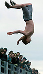 Buddy Nelson performs a backward somersault during the 24th annual Polar Bear jump into the Burley lagoon in Olalla, Washington on January 1, 2008. Jim Bryant Photo. ©2010. ALL RIGHTS RESERVED.