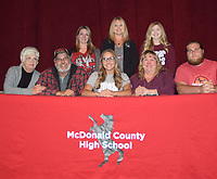 RICK PECK/SPECIAL TO MCDONALD COUNTY PRESS Erin Wolfe (bottom, center) recently signed to join the Sugar Bear Dance Team at Missouri State University in Springfield. Front row, left is Ginger Wolfe (grandma), Dennis Wolfe (dad), Erin Wolfe, Nancy Wolfe (mom) and Elliott Wolfe (brother); and (back,left) is Dance instructors Kelsey Hughes, Sandra Ables and Eden LeGrand.