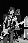 "Jimmy McCulloch  Wings Tour 1975.Sound check. The photographs from this set were taken in 1975. I was on tour with them for a children's ""Fact Book"". This book was called, The Facts about a Pop Group Featuring Wings. Introduced by Paul McCartney, published by G.Whizzard. They had recently recorded albums, Wildlife, Red Rose Speedway, Band on the Run and Venus and Mars. I believe it was the English leg of Wings Over the World tour. But as I recall they were promoting,  Band on the Run and Venus and Mars in particular."