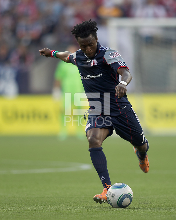 New England Revolution forward Kenny Mansally (7) passes the ball. In a Major League Soccer (MLS) match, the New England Revolution tied the Chicago Fire, 1-1, at Gillette Stadium on June 18, 2011.