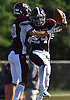Trevor Yeboah-Kodie #24 of Garden City, right, gets congratulated by Holden Overbeck #10 after rushing for a 51-yard touchdown in the third quarter of a Nassau County Conference II varsity football game against Carey at Garden City High School on Saturday, Sept. 29, 2018. Garden City won by a score of 38-14.