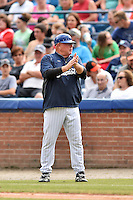 Asheville Tourists development supervisor Marv Foley coaches first base during a game against the Columbia Fireflies at McCormick Field on June 17, 2016 in Asheville, North Carolina. The Tourists defeated the Fireflies 6-2. (Tony Farlow/Four Seam Images)