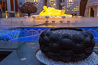 Nanjing, Jiangsu, China.  Buddha Sculpture in Usnisa Palace, Niushou Mountain.  Lotus Sculpture in Foreground.