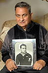 Richard Jenke holds a photo of himself taken on his 18th birthday in 1945 during an interview at his Heights home Friday  Feb. 15,2008.(Dave Rossman/For the Chronicle)