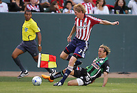 Santos Laguna forward Vicente Vuoso (30) slides Chivas USA defender Jim Curtin (3). Chivas USA defeated the Santos of Laguna 1-0 during the 1st round of the 2008 SuperLiga at Home Depot Center stadium, in Carson, California on Wednesday, July 16, 2008.