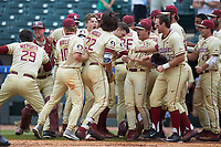 Drew Mendoza (22) of the Florida State Seminoles is mobbed by his teammates at home plate after hitting a 3-run home run against the North Carolina Tar Heels during the 2017 ACC Baseball Championship Game at Louisville Slugger Field on May 28, 2017 in Louisville, Kentucky.  The Seminoles defeated the Tar Heels 7-3.  (Brian Westerholt/Four Seam Images)