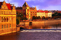 Late afternoon sunlight along the emabankment of the river Vtlava traversing Prague (Czech Republic)