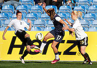 USA's Tobin Heath fights for the ball with Germany's Anja Mittag during their Algarve Women's Cup soccer match at Algarve stadium in Faro, March 13, 2013.  .