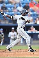 Charleston RiverDogs center fielder Estevan Florial (8) swings at a pitch during a game against the Asheville Tourists at McCormick Field on July 5, 2017 in Asheville, North Carolina. The RiverDogs defeated the Tourists 10-9. (Tony Farlow/Four Seam Images)