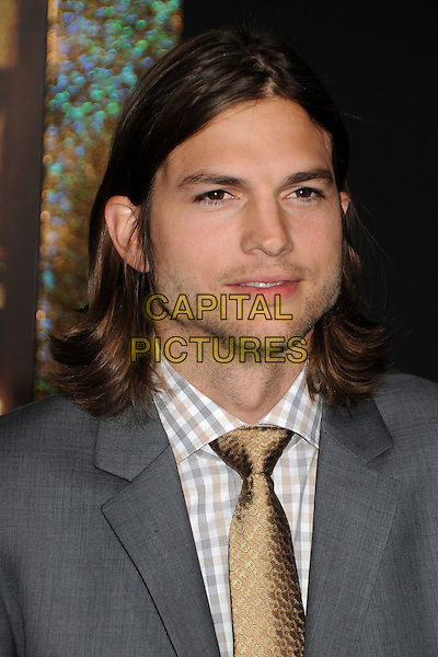 Ashton Kutcher.'New Year's Eve' Los Angeles premiere at  Grauman's Chinese Theatre, Hollywood, California, USA..5th December 2011.headshot portrait grey gray suit jacket stubble facial hair check shirt white yellow tie.CAP/ADM/BP.©Byron Purvis/AdMedia/Capital Pictures.